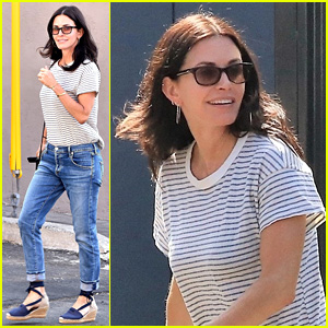 Courteney Cox Sports Denim Pants & Wedges for Furniture Shopping Trip