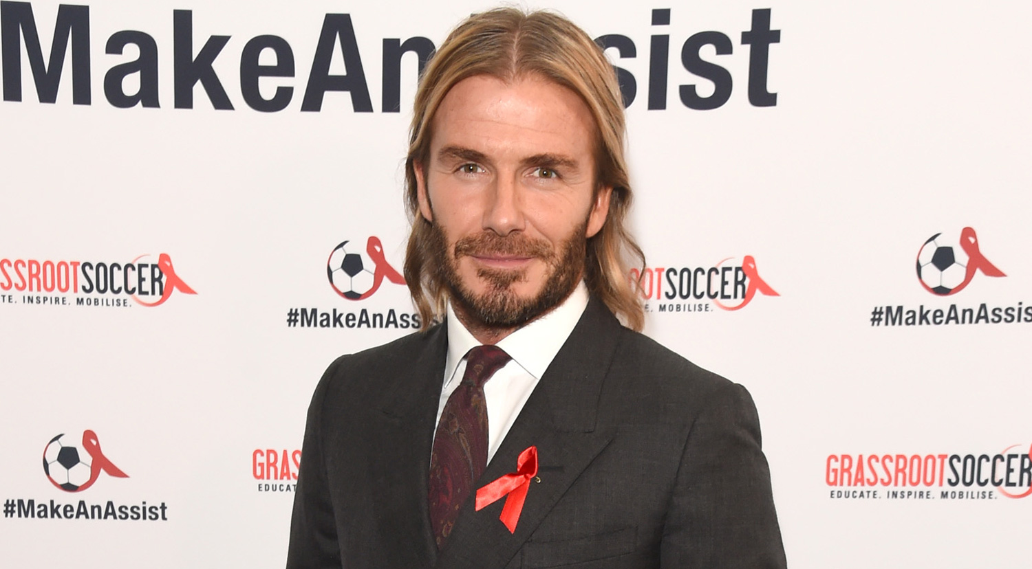David Beckham Lets His Long Hair Flow At World Aids Day Event