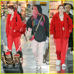Bella Thorne Rocks a Red Outfit While Arriving at the Airport With Boyfriend Mod Sun