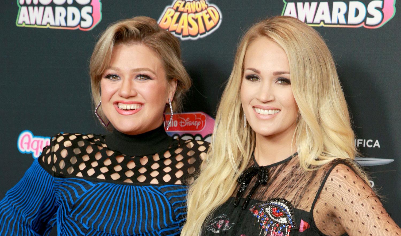 American Idol's Kelly Clarkson & Carrie Underwood Reunite at Radio Disney Music Awards 2018!