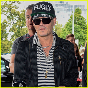 a0feb00ce46 Johnny Depp flashes a smile as he arrives at the Warsaw Airport on  Wednesday afternoon (June 13) in Warsaw