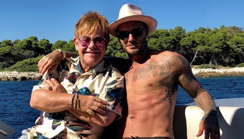 elton john hangs out with shirtless david beckham in