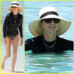 Charlize Theron Sports Striped Bikini Bottoms at Atlantis Resort in the Bahamas!