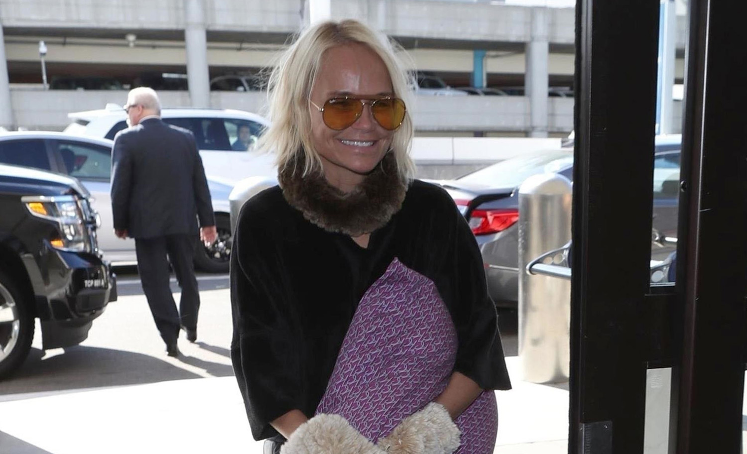 Kristin Chenoweth Catches A Flight With Her Dog Thunder