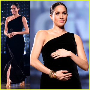 Pregnant Meghan Markle Cradles Growing Baby Bump at The Fashion Awards 2018