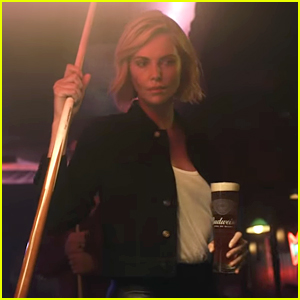 Charlize Theron Never Spills Her Budweiser While Kicking Ass in Bar Games - Watch Now!