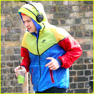 Harry Styles Sports Colorful Jacket While Jogging in London
