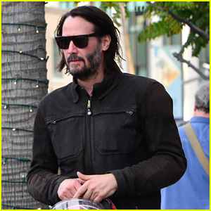 Keanu Reeves Hops on His Motorcycle After Lunch Meeting