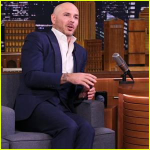Pitbull Says He Inspired John Travolta to Shave His Head!