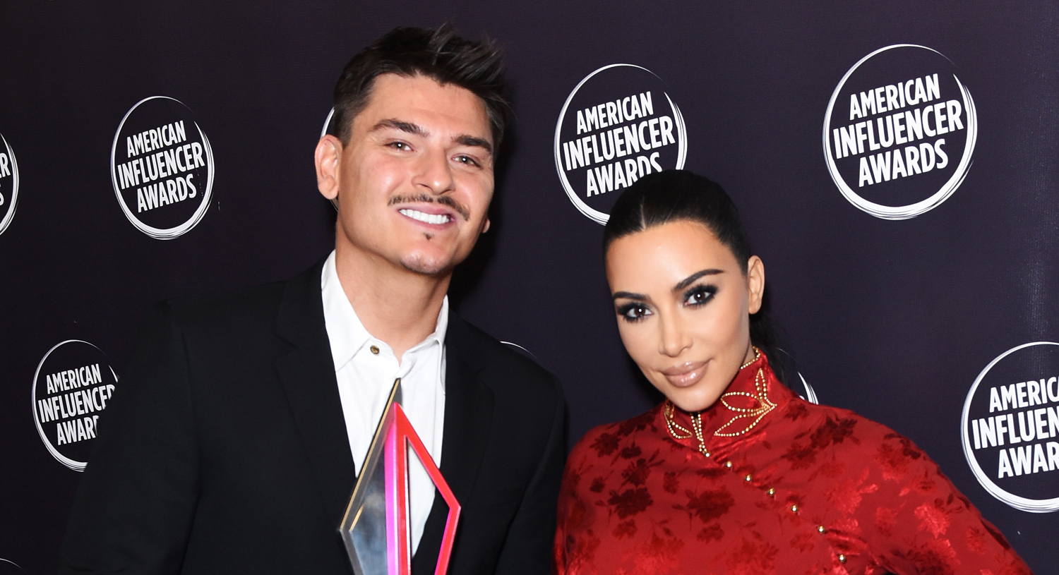 Kim Kardashian Honors Longtime Makeup Artist Mario Dedivanovic at American Influencer Awards 2019