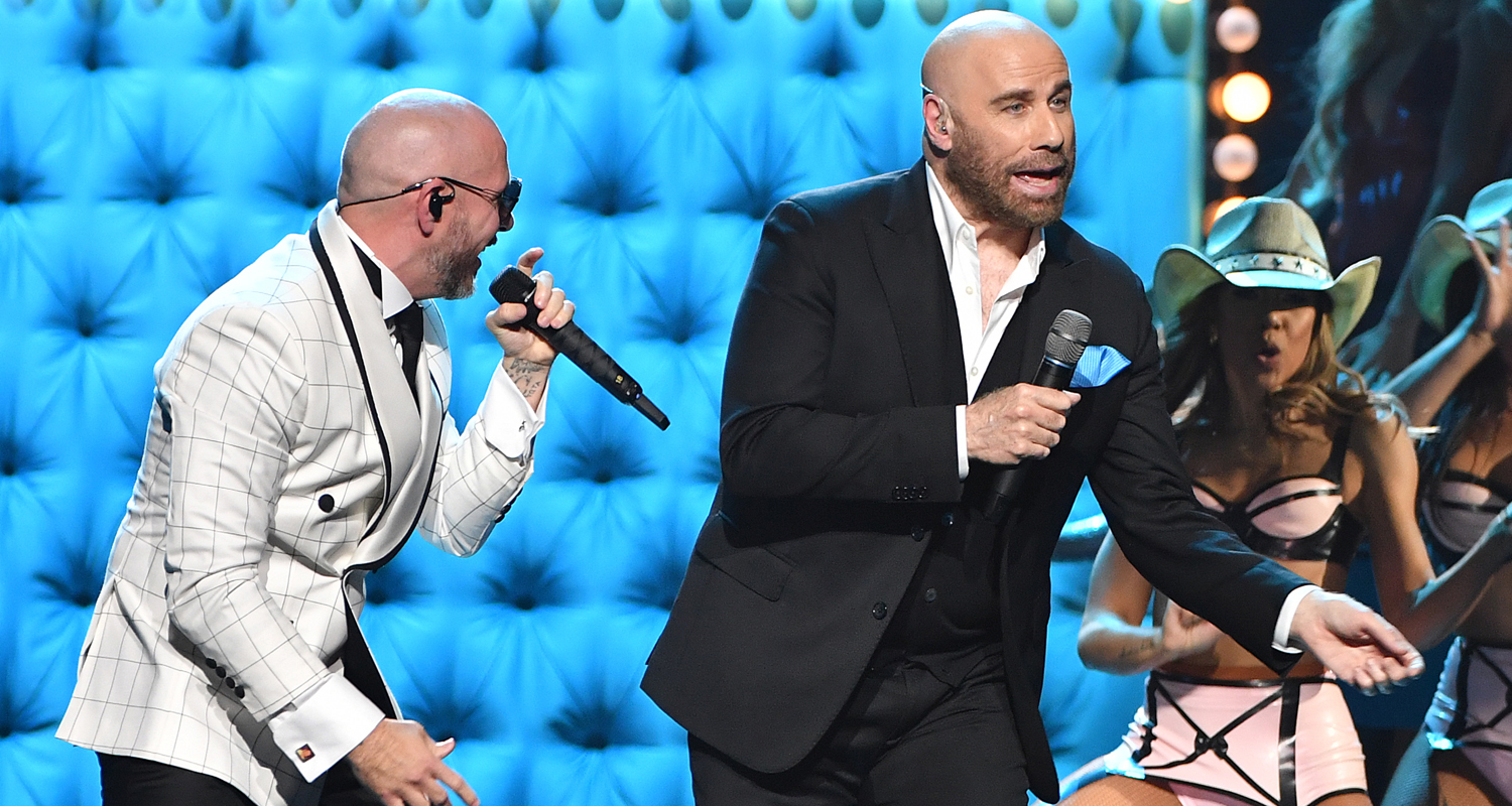 John Travolta Teams Up with Pitbull for Live Performance at Univision's Premio Lo Nuestro 2020 – Watch Here!
