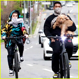 Usher Carries His Dog on Bike Ride with Girlfriend Jennifer Goicoechea