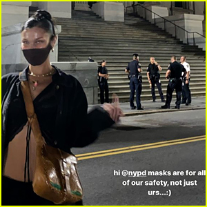 Bella Hadid Flips Off Police for Not Wearing Face Masks