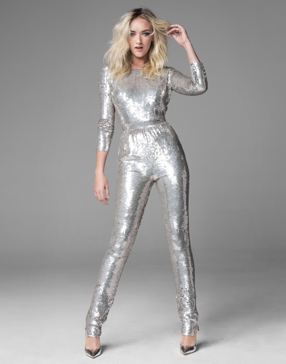 Daisy Clementine Smith pose for a solo portrait in a silver outfit