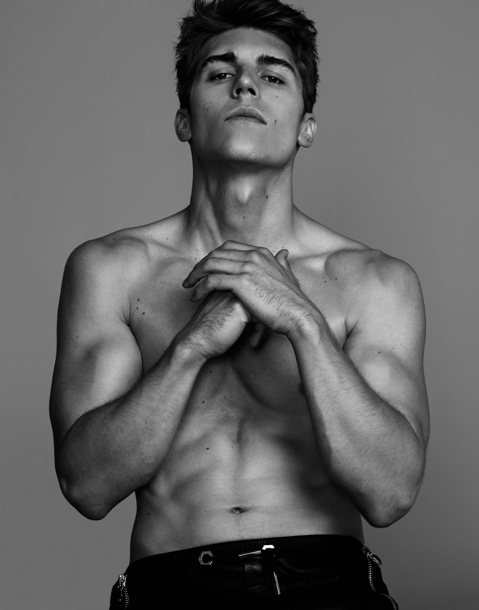 Nolan Funk shirtless and making a fist